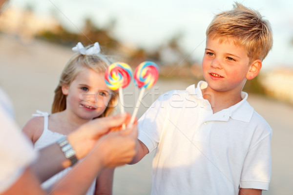 Cute Brother and Sister Picking out Lollipop Stock photo © feverpitch
