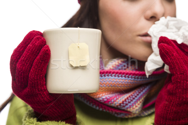 Young Sick Woman Holding Cup with Blank Tea Bag Hanging Stock photo © feverpitch