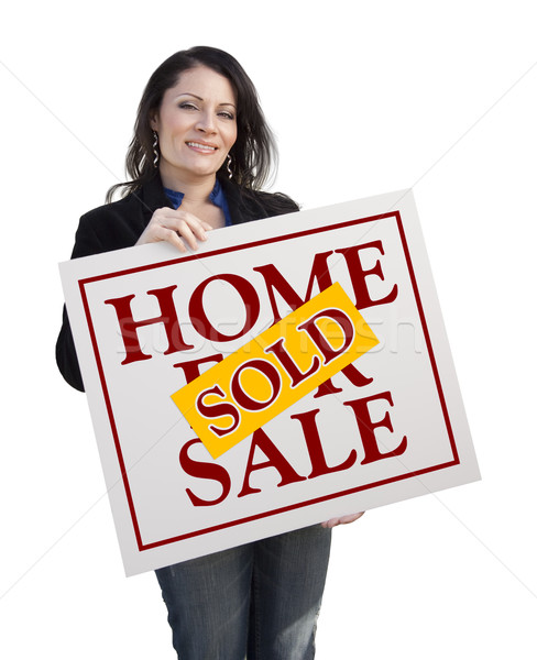 Hispanic Woman Holding Sold Home For Sale Sign on White Stock photo © feverpitch