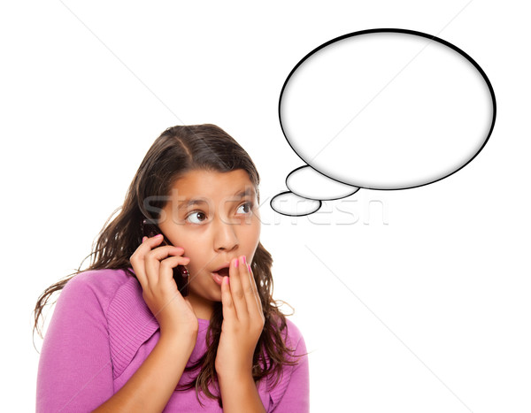 Shocked Hispanic Teen Aged Girl on Phone with Blank Thought Bubb Stock photo © feverpitch