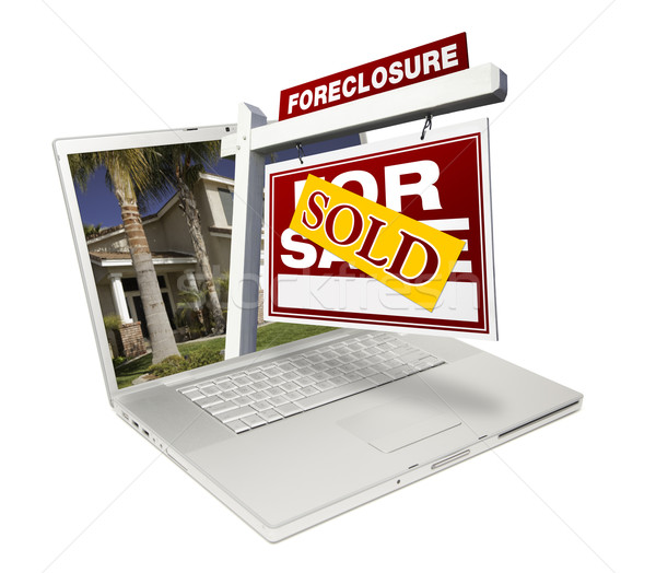 Stock photo: Sold Foreclosure Home for Sale Real Estate Sign Laptop