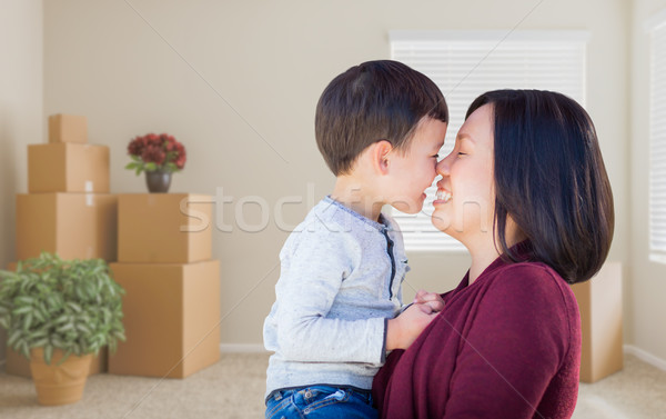 Mixed Race Chinese Mother and Child in Empty Room with Packed Mo Stock photo © feverpitch