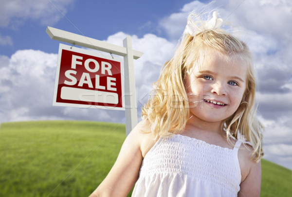 Smiling Cute Girl in Field with For Sale Real Estate Sign Stock photo © feverpitch