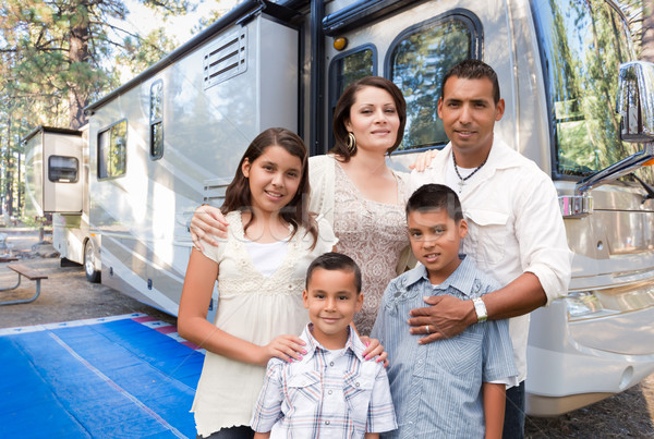 Happy Hispanic Family In Front of Their Beautiful RV At The Camp Stock photo © feverpitch