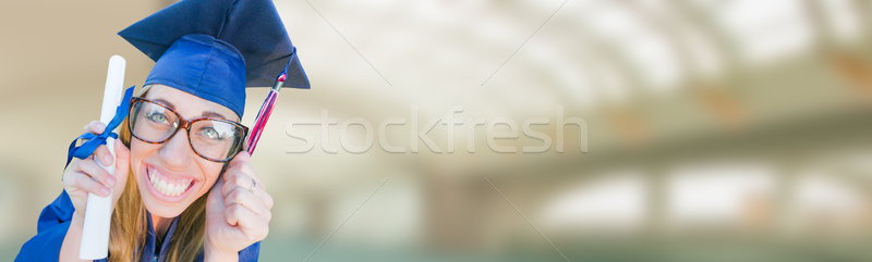 Goofy Graduating Young Girl In Cap and Gown Banner. Stock photo © feverpitch
