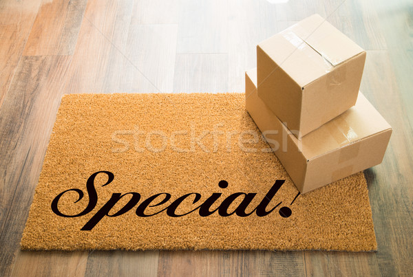 Special Welcome Mat On Wood Floor With Shipment of Boxes Stock photo © feverpitch