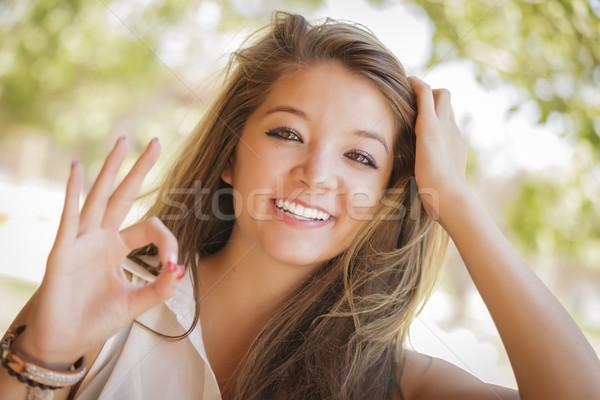 привлекательный девушки портрет хорошо рукой знак Сток-фото © feverpitch