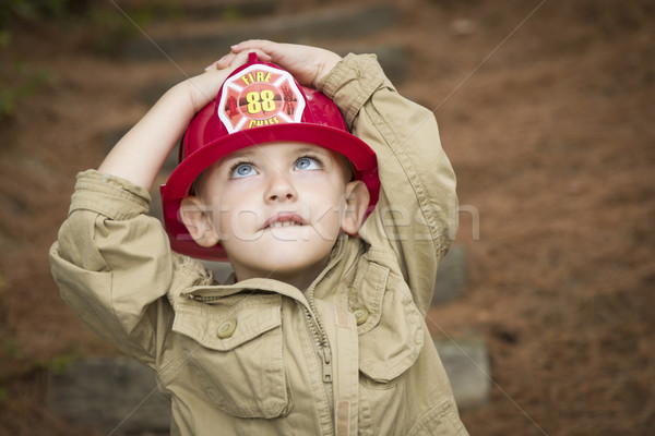 Adorable Child Boy with Fireman Hat Playing Outside Stock photo © feverpitch