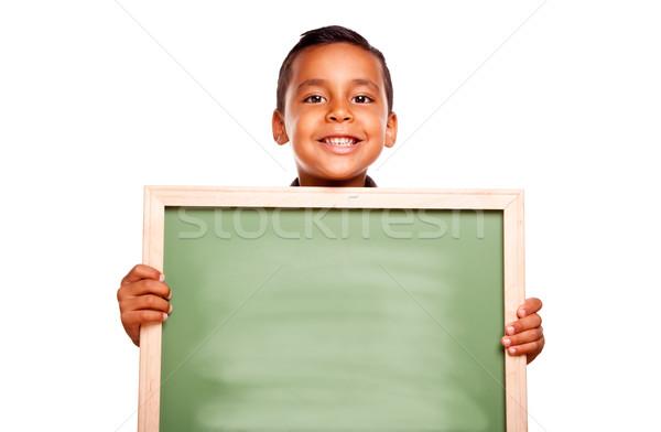 Aranyos spanyol fiú tart üres tábla kész Stock fotó © feverpitch