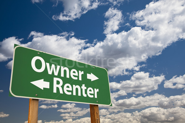 Owner, Renter Green Road Sign Over Clouds Stock photo © feverpitch