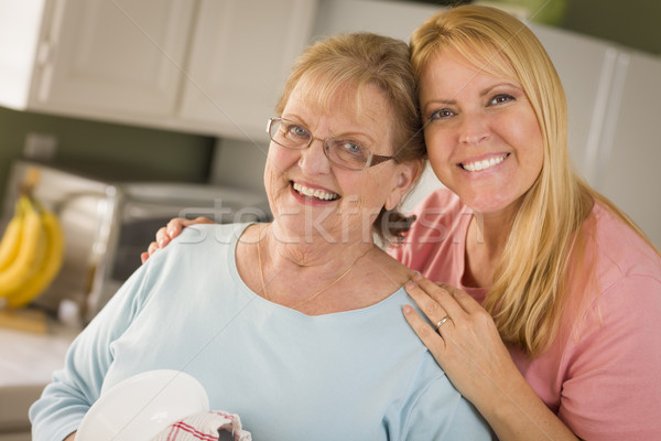 Senior Adult Woman and Young Daughter Portrait in Kitchen Stock photo © feverpitch