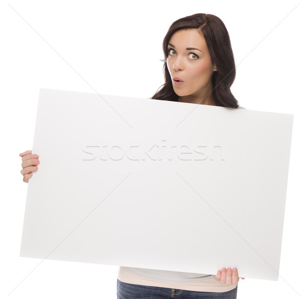 Wide Eyed Mixed Race Female Holding Blank Sign on White Stock photo © feverpitch