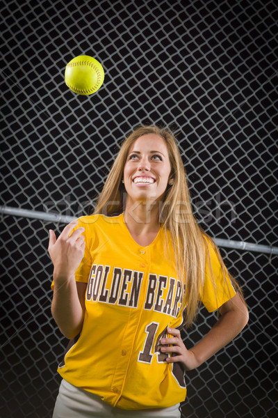 Female Softball Player Portrait with Ball in the Air. Stock photo © feverpitch