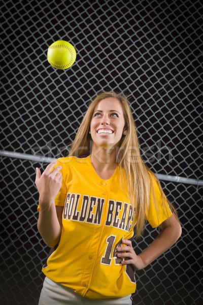 Vrouwelijke softbal speler portret bal lucht Stockfoto © feverpitch