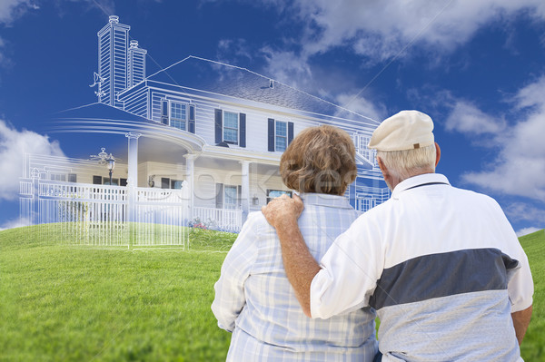 Senior Couple Faces Ghosted House Drawing, Green Grass Hill Behi Stock photo © feverpitch