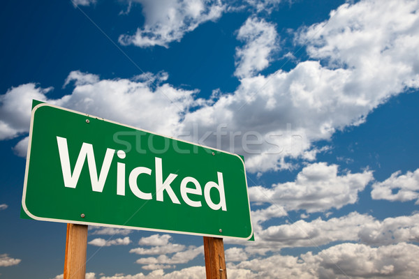 Wicked Green Road Sign with Sky Stock photo © feverpitch