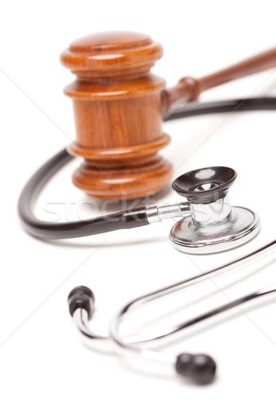 Black Stethoscope and Gavel on White Stock photo © feverpitch