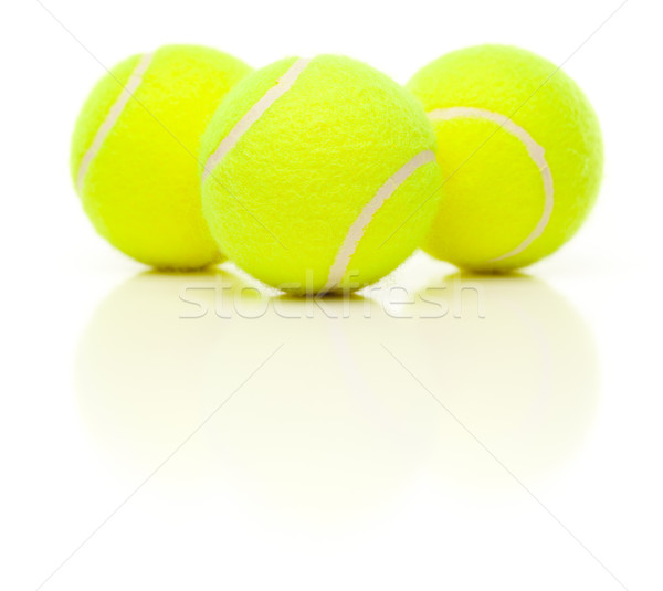 Three Tennis Balls on White with Slight Reflection Stock photo © feverpitch