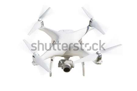 Unmanned Aircraft System (UAV) Quadcopter Drone Isolated on Whit Stock photo © feverpitch