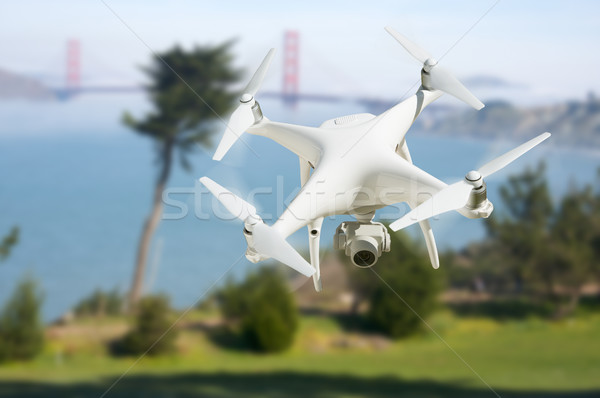 Unmanned Aircraft System (UAV) Quadcopter Drone In The Air Near  Stock photo © feverpitch