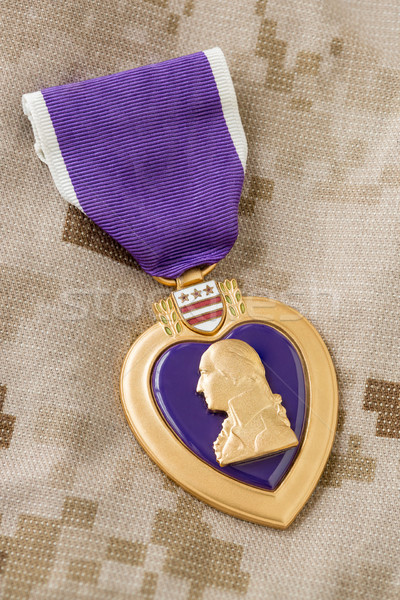 Purple Heart Medal Laying on Military Fatigues Stock photo © feverpitch