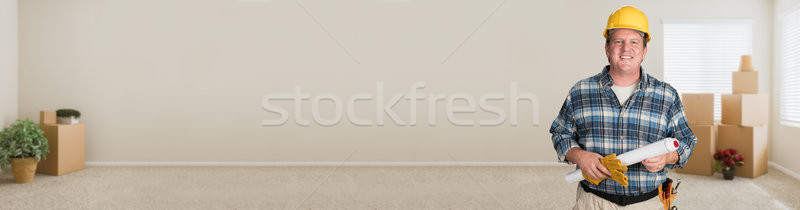 Contractor in Hard Hat with Plnas and Hard Hat in Empty Room wit Stock photo © feverpitch