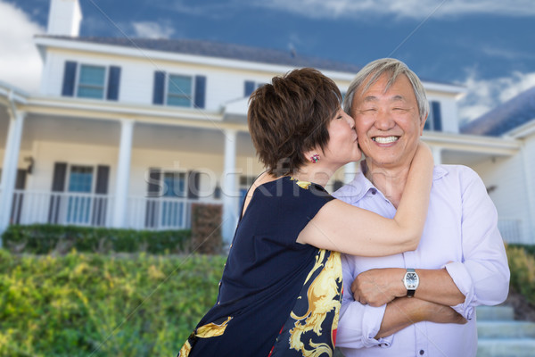 Happy Chinese Senior Adult Couple Kissing In Front Of Custom Hou Stock photo © feverpitch