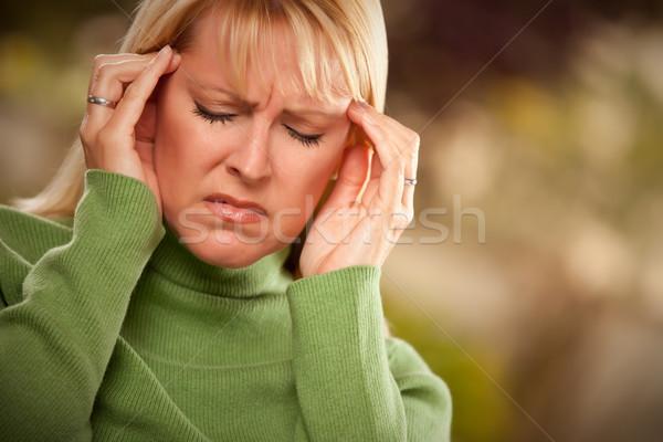 Grimacing Woman Suffering a Headache Stock photo © feverpitch
