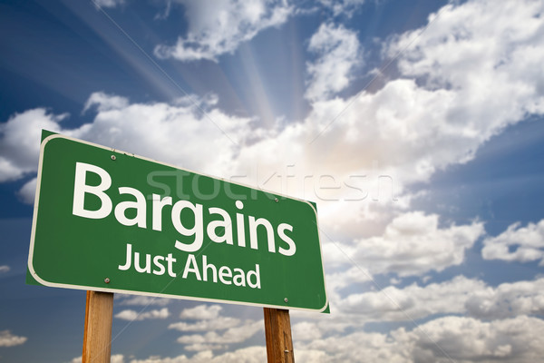 Bargains Just Ahead Green Road Sign and Clouds Stock photo © feverpitch