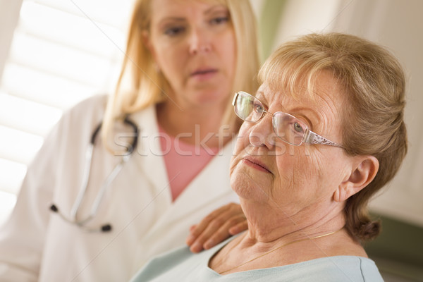 Senior Adult Woman Being Consoled by Female Doctor or Nurse Stock photo © feverpitch
