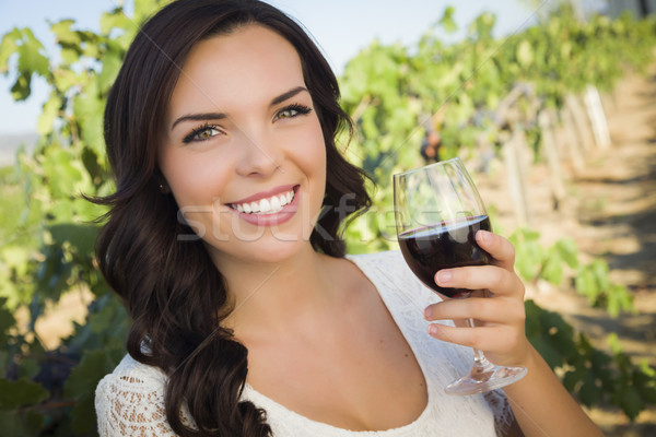 Young Adult Woman Enjoying A Glass of Wine in Vineyard Stock photo © feverpitch
