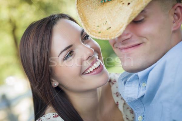 Romantica Coppia cappello da cowboy flirtare parco Foto d'archivio © feverpitch