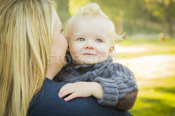 Mother Embracing Her Adorable Blonde Baby Boy