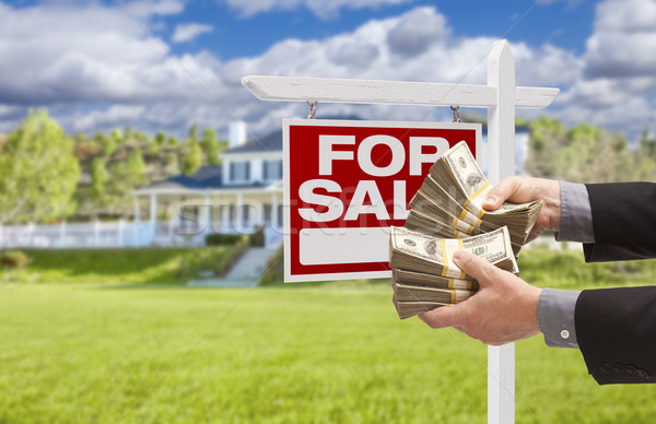 Man Handing Over Money in Front House For Sale, Sign Stock photo © feverpitch