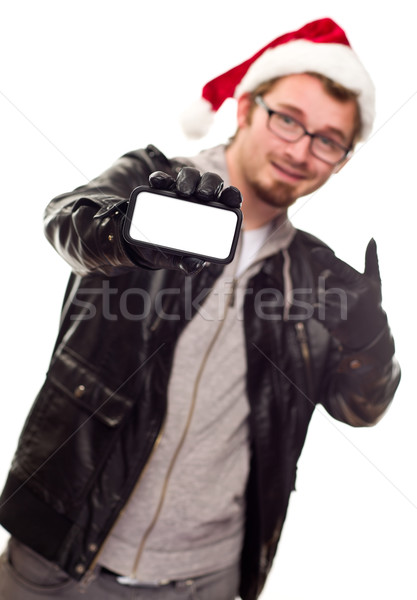 Man with Santa Hat Holding Out Blank Cell Phone Stock photo © feverpitch
