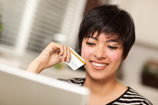 Smiling Multiethnic Woman Holding Credit Card Using Laptop Stock photo © feverpitch