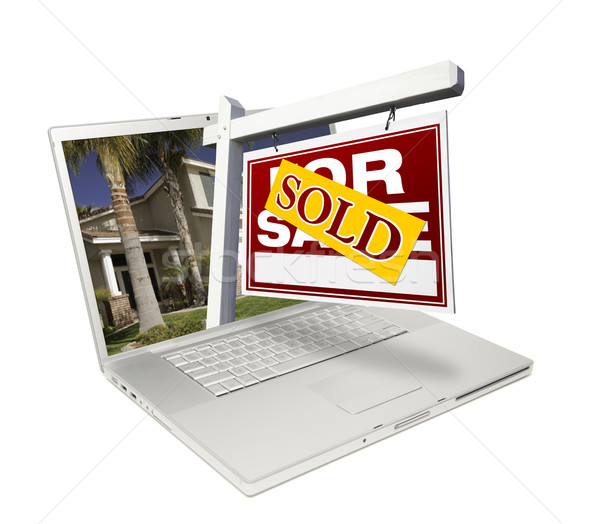 Sold Home for Sale Sign & New House Laptop Stock photo © feverpitch