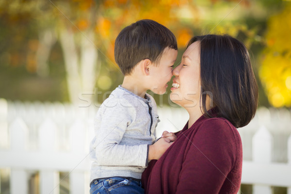 Chinese Mom Having Fun and Holding Her Mixed Race Boy Stock photo © feverpitch