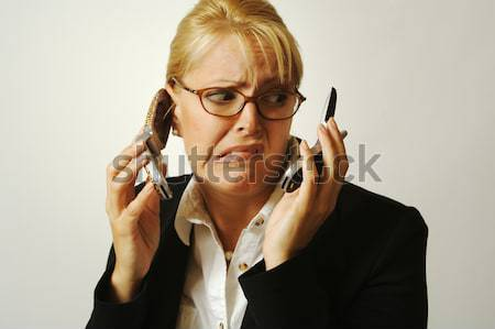 Angry Business Woman on Cell Phone Stock photo © feverpitch