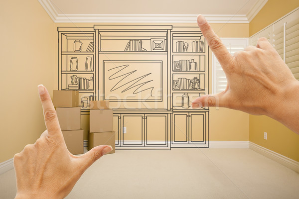 Stock photo: Hands Framing Drawing of Entertainment Unit In Empty Room