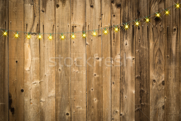 Lustrous Wooden Background with String of Lights Stock photo © feverpitch