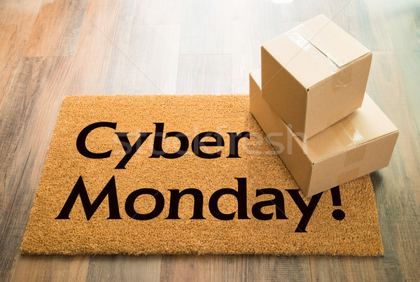 Cyber Monday Welcome Mat On Wood Floor With Shipment of Boxes Stock photo © feverpitch