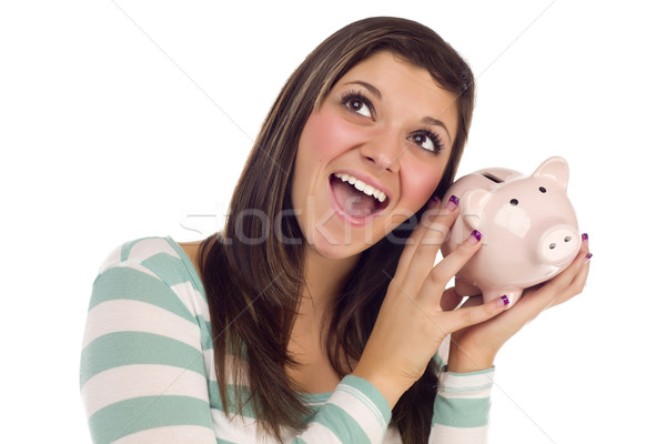 Ethnic Female Daydreaming and Holding Pink Piggy Bank Stock photo © feverpitch