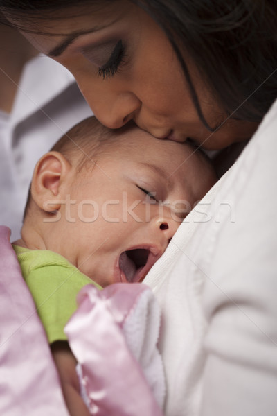 Attractive Ethnic Woman with Her Yawning Newborn Baby Stock photo © feverpitch