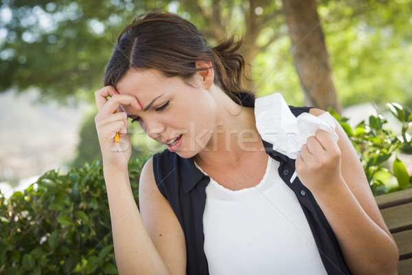 Upset Young Woman with Pencil and Crumpled Paper in Hand Stock photo © feverpitch