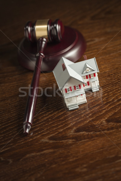 Gavel and Small Model House on Table Stock photo © feverpitch
