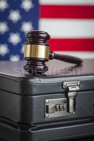 Briefcase and Gavel Resting on Table with American Flag Behind Stock photo © feverpitch