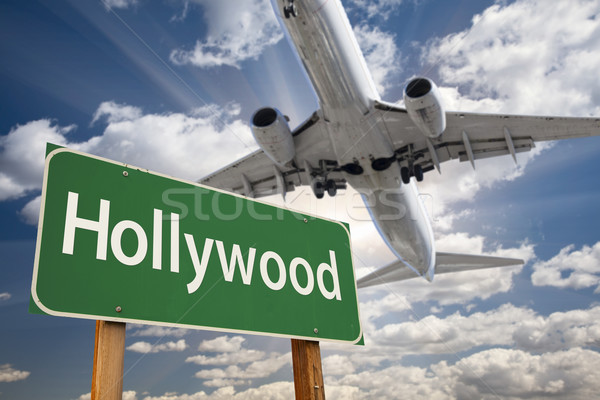 Hollywood Green Road Sign and Airplane Above Stock photo © feverpitch