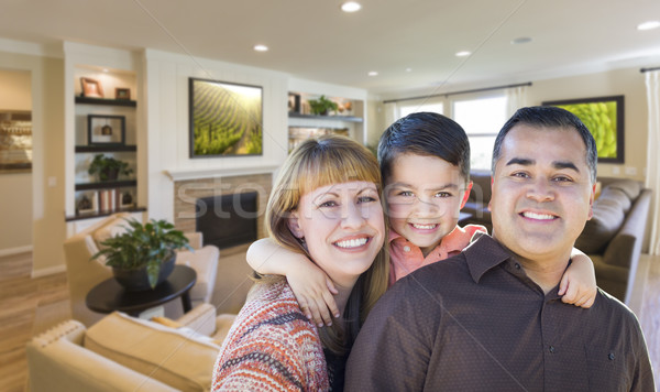 Young Mixed Race Family Portrait In Living Room of Home Stock photo © feverpitch