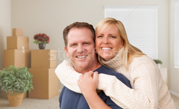 Young Couple in Empty Room with Packed Boxes Stock photo © feverpitch